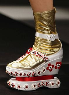 Prada's six-inch flat platforms in Perspex and leather looked as if they we - Evening Standard