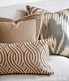 Mix it up! Playing with fabrics and patterns adds dimension. Here, living room pillows feature a viscose-and-linen undulating stripe, a solid linen with braid, and a silk ikat. - Traditional Home ® / Photo: Bruce Buck / Design: Stephen Elrod