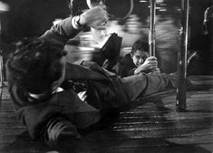 Robert Walker and Farley Granger in Strangers on a Train (Alfred Hitchcock, - The merry-go-round scene was one of the most frightening movie endings I ever experienced as a child. Alfred Hitchcock, Hitchcock Film, Ruth Roman, Entertainment Weekly, Farley Granger, Train Movie, Robert Walker, Crime Film, The Villain