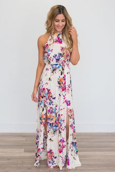Shop our Gardenia Floral Print Maxi Dress - Ivory Multi. Featuring an elastic waistline and halter tie neck. Free shipping on all US orders!