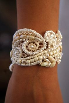 Beads sewn on to vintage lace. I imagine you looking lovely with a thicker bracelet like this, perhaps vintage looking