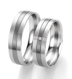 Breuning wedding rings: two tone with 3 princess cut diamonds.