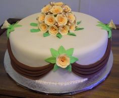 Apricot, beige and brown fruitcake wedding cake.