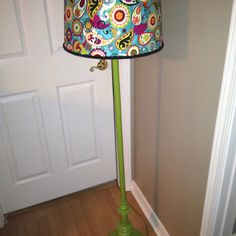 Painted old brass floor lamp and covered lamp shade with fabric.