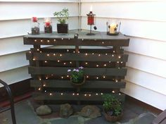 I love how this came out so I thought I'd share my photo. Two pallets nailed together, I trimmed them down one row. Then I spray painted them a dark bronze and I placed 4 floor stone tiles on top.…