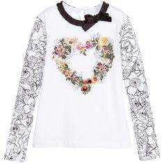 Girls white t-shirt by Love Made Love with long sleeves in a black floral print. Made in a soft cotton jersey with a button on the back to fasten. The neckline is finished in a black ruffled ribbon with a bow on the front. On the front is has a bold floral print in the shape of the heart with sequins, beads and diamanté embellishment.  This top comes in a dual size and as an example a size 4-5 year top will be true to size fitting on a five year old and larger fitting on a four year old…