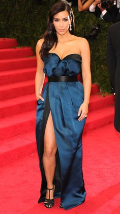 Kim wore an elegant strapless black and blue Lanvin gown, complete with a high slit, for the 2014 Met Gala honoring Charles James. She finished the ensemble with some wow-worthy Lorraine Schwartz diamond drop earrings.