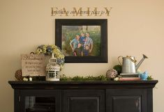 """Love the picture with family portrait with """"family"""" above it"""