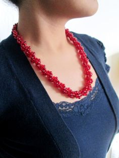 This listing is for a Red Mini Mixed Bead Necklace. It is made up of mixed red beads in a spiral pattern to create a sophisticated, yet great, basic look.