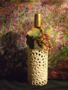 Wine bottle cover..crochet covered glass wine bottle lamp.