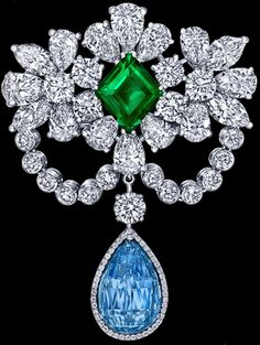 Diamond-set brooch with a central emerald and an aquamarine drop.
