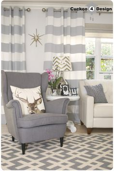 grey Strandmon chair and deer pillowa  curtains and rug!