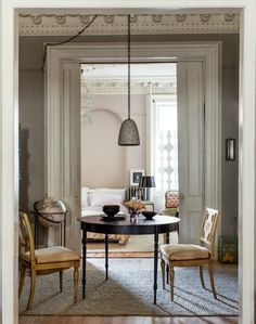 Designer Hilary Robertson's Brownstone Interior.  Love the simple jute rug under the table.