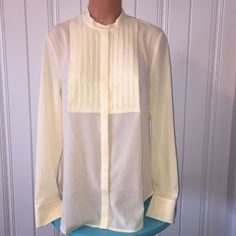 NWT J Crew Tuxedo Button Down Ivory Blouse Sz M Perfect to wear all year! Nice and light weight! 100% Polyester! Looks great with anything!! New with tags! Color is warm Ivory! Size M! I own this top and wear it tucked in a skirt, with slacks and even jeans! You will get tons of compliments! J. Crew Tops Button Down Shirts