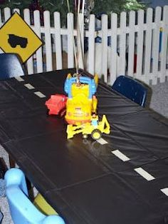 Second birthday idea! Gotcha Day or Baby shower. An easy way to decorate a table.or trash bags.with silver duck tape. Cute for a boy baby shower or bday party. Construction Birthday Parties, Cars Birthday Parties, Construction Party, Birthday Fun, Birthday Ideas, Digger Birthday, Birthday Banners, Birthday Invitations, Hot Wheels Birthday