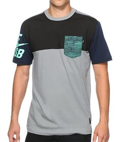 A colorblocked black and grey body accents navy sleeves with a mint Nike SB Swoosh graphic plus a mint woodgrain print chest pocket.