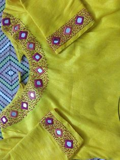 Discover recipes, home ideas, style inspiration and other ideas to try. Mirror Work Blouse Design, Patch Work Blouse Designs, Simple Blouse Designs, Saree Embroidery Design, Hand Embroidery Dress, Embroidered Blouse, Saree Blouse Neck Designs, Kurta Neck Design, Churidar Designs