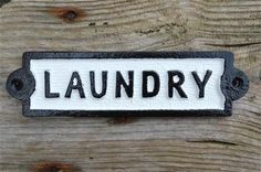 A vintage style laundry sign. Made from solid cast iron with a hand painted finish, supplied with slotted head fixing screws. The sign measures 20.3cm wide and 5.5cm tall or 8 inches wide and 2 1/8 inches tall.