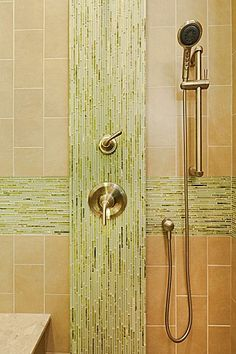 The shower is accented with this green glass and marble tile. The shower valves and handles are bumped out and encompassed in the beautiful. Shower Backsplash, Small Bathroom Tiles, Shower Valve, Building A House, Door Handles, Home Improvement, House Design, Contemporary, Bath Time