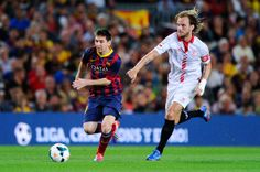 Lionel Messi of FC Barcelona duels for the ball with Ivan Rakitic of Sevilla FC during the La Liga match between FC Barcelona and Sevilla FC at Camp Nou on September 14, 2013 in Barcelona, Catalonia.