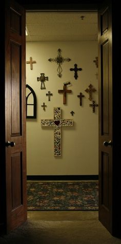 cross wall inspiration - my house is currently COVERED in my mother in law's crosses, and they're coming with us when we move.