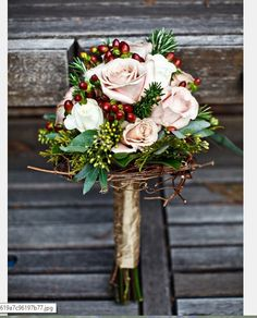 Very pale antique pink roses, seeded eucalyptus and honeysuckle branches, dark burgundy hypericum berries. Wrapped stems in golden antique satin.