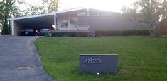 Neutraface font to front our abode.     We're busy making stuff happen. Outside. While the weather is perfect. Let's take a look.  Our lawn...