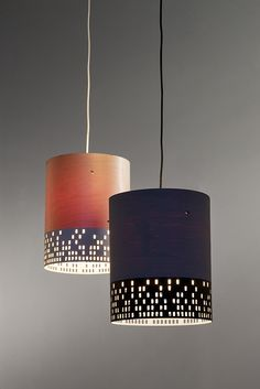 City Pendant lamp, by UM Project. Combination of wood + metal - translucent veneer trimmed with what looks like laser-cut metal
