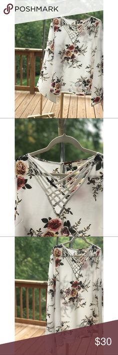 Apricot Lane White Floral Flirty & Flowy Blouse. Apricot Lane Size Large Flirty & Flowy Top. Romantic & undone. Yet perfectly put together. Clean lines and Bell Sleeve accentuate any beauties natural IT-ness. I pair this with soft loose light wash boyfriend jeans and combat boots, black.Happy Poshing! Tops Blouses