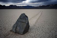 Sailing stones in the dry lakebed of Racetrack, Death Valley, as big as 700 pounds, misteriously slide across the surface of the earth without any notable external forces acting upon them.