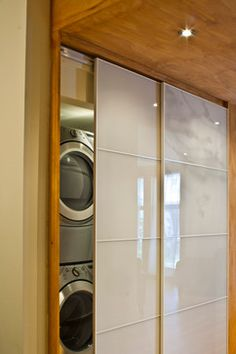 Zen-like sliding doors to the laundry room. First-time home owners - modern - laundry room - montreal - Emily Campbell