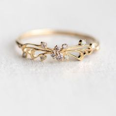 Our butterfly inspired diamond Small Changes rings are back in stock in 14k yellow rose and white gold! at melaniecasey.com