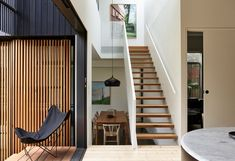 The Ridgeway House saw Ha Architecture work closely with fellow architect Steve Coster to design a compact charred timber extension to a Victorian weatherboard.