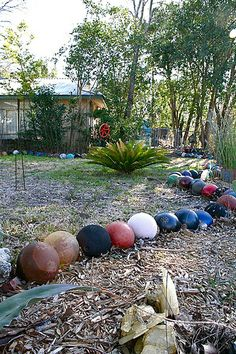 1401 Corona Drive in Austin, Texas. Where do bowling balls go when they've lost their (rock and) roll? LuCretia Sisk's front yard seems to be the place.  Several hundred bowling balls tastefully arranged in this yard featured by Texas Monthly!