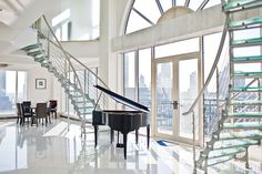 Ms. Jin said she spent about 1 USD million in interior design and customization of the penthouse. Twin staircases, shown here, were designed and engineered in China and then flown to New York, where they were installed piece by piece.