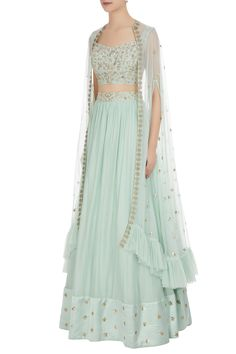Buy Cutdana & sequin embroidered cape with lehenga & bustier by Mani Bhatia at Aza Fashions Party Wear Western Gowns, Party Wear Indian Dresses, Indian Gowns Dresses, Indian Fashion Dresses, Indian Wedding Outfits, Indian Designer Outfits, Girls Fashion Clothes, Indian Outfits, Stylish Dresses For Girls