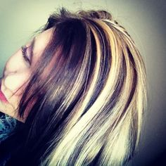 Blonde highlights and lowlights, dark bangs. Love it <3