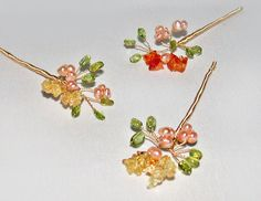 These floral hair pins are crafted with a dreamy combinations of golden citrine, pale green peridot, earthy carnelian and blush color natural pearls. They measure about 1 1/2 in diameter on 3 long bendable pin. Available in gold or silver finish.