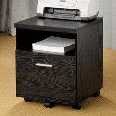 "Home Office Mobile File Cabinet in Black Finish by Coaster Home Furnishings. $85.52. File Cabinet. File Storage. Home Office Furniture. Filing Cabinet. Mobile Cabinet. Dimension: 18 1/8""W x 17 3/4""D x 22 7/8""H Finish: Black Material: Wood Home Office Mobile File Cabinet in Black Finish Features storage drawer, open shelf and casters for easy mobility. Clean lines and functional. Item is designed to be practical in use and to beautify your home decor. Matching b..."