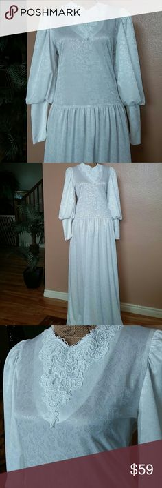 Pretty purely white vintage style long dress So purely pretty is this white vintage inspired white long dress. Beautiful blousy sleeves with long cuffs. Zip up back. Soft gathers at the hips. Pretty lace detail on the bodice. Polyester. Beautiful cond. LeVoys Dresses