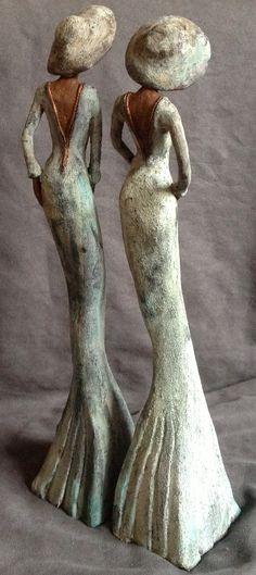 Erica Straatman , kunst van keramiek, uilen, lange vrouw figuren, vogels, afrikaanse figuren en afrikaanse portretten
