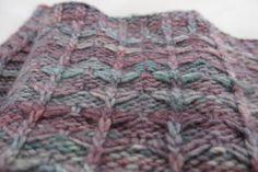 Abriachan Cowl is the perfect knitting pattern for variegated yarn. This cowl has slipped stitches, and gathered strands of yarn running across it to really showcase the different colours. A perfect knitting pattern for multicoloured yarns!