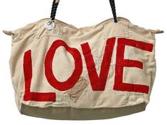Medium LOVE Weekend Bag from Lamu in Kenya Handmade of old tangas (100% cotton sail cloths) and painted in the mood of the motion. With 2 way zipper, waterresistant lining. Pocket inside for mobile, keys or wallet. Size: ca. 40 x 60 cm Please see this short film on You Tube on