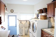 Our Mudroom and Laundry Room - Finding Home....I love those really cute DIY hampers and blue door☺