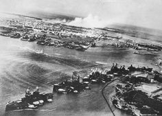 Captured Japanese photograph taken during the attack on Pearl Harbor, December 7, 1941. In the distance, the smoke rises from Hickam Field.