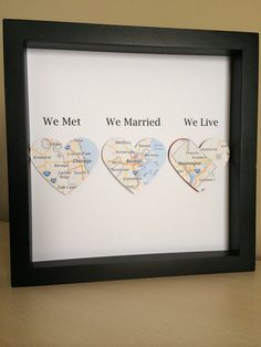 A lovely gift for a wedding or anniversary. We met, We Married, We Live This design has been lovingly made by using maps of locations. Every design will be tailored made to the locations you desire. Each map heart will be mounted to a heart of your color choice.    Each Paper Line piece comes framed in a contemporary black or white shadow box frame measuring 8x8 inches. (please note that these photographs are taken without the frames glass to reduce glare)    With your order please include…