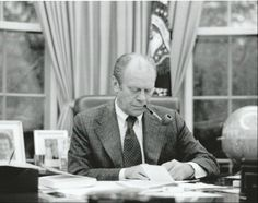 President Gerald R. Ford in the Oval Office.  He was well known for being a pipe smoker.