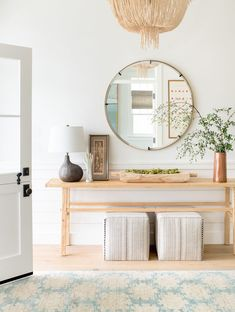 Entry console table decor ideas for your foyer. White trim work with a light wood table, round mirror, and matching lamps to decorate entryway. way table decor 5 Entry Console Table Decor Ideas you'll Love Wood Console Table, Decor, Table Style, Foyer Decor, Foyer Design, Interior, Table Decorations, Home Decor, Entry Console Table