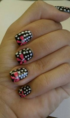 Black and white dots with pink bow nails