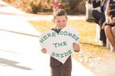 """My adorable ring bearer and our homemade """"Here Comes the Bride"""" sign!"""